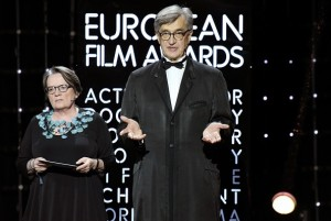 Directors Agnieszka Holland and Wim Wenders stand on stage during the 28th European Film Award ceremony in Berlin on December 12, 2015.